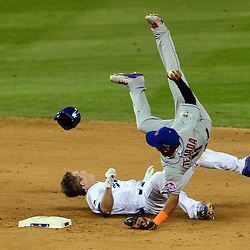 Los Angeles Dodgers' Chase Utley (26) is called safe after a review at second base as New York Mets shortstop Ruben Tejada (11) flips over the top and leaves the game with a leg injury in the seventh inning of a Major League Baseball National League Division Series game on Saturday, Oct. 10, 2015 in Los Angeles. <br /> (Photo by Keith Birmingham/ Pasadena Star-News)