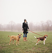 Lady walking her dogs in Prospect Park in Brooklyn, New York. 2011