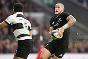 Twickenham, Surrey. England.  All Blacks, Scrum Half, TJ PERENARE, try's the avoid the tackle from Baa Baa's Vince ASO,  during the Killik Cup, Barbarians vs New Zealand. Twickenham. UK.<br /> <br /> Saturday  04.11.17<br /> <br /> [Mandatory Credit Peter SPURRIER/Intersport Images]