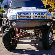 A Dodge Ram with serious lift kit and custom skulls parked on the side of the road in Eagle, Colorado.