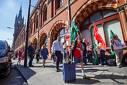 © Licensed to London News Pictures. 12/08/2016. London, UK. Eurostar passengers go past at a picket line of Eurostar staff on strike outside St Pancras station in London as international rail passengers face a 4 day of travel chaos because of four separate Eurostar strikes in a dispute over members' work-life balance. Photo credit: Tolga Akmen/LNP