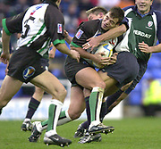 14/12/2003 - Photo  Peter Spurrier.2003/04 Parker Pen Challenge  Cup: London Irish vs Montauban.Montauban centre Jerome Sieurac is takleed by Exiles Justin Bishop.   [Mandatory Credit, Peter Spurier/ Intersport Images].