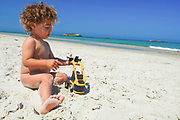 Toddler of three plays on the beach  - Portal Editing Team has selected this image for Photodisc.