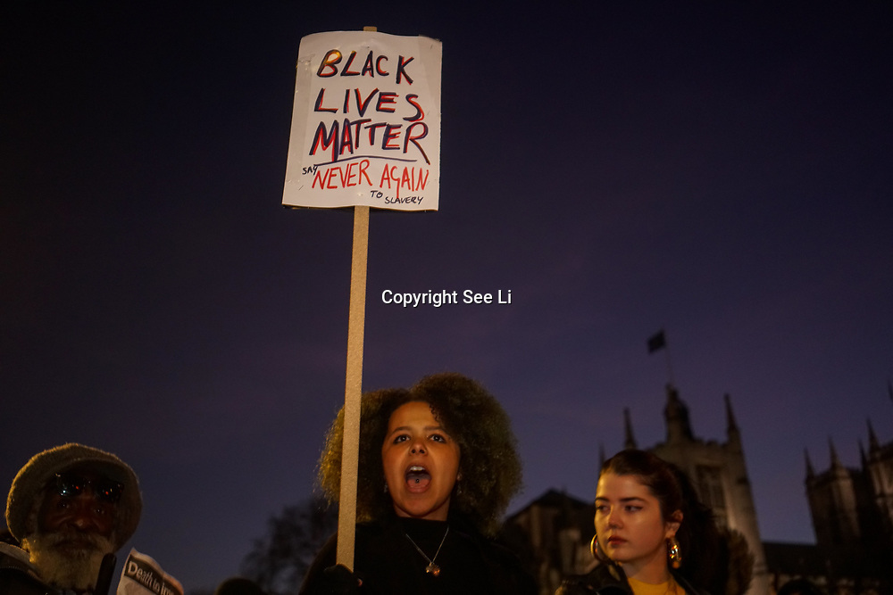London, England, UK. 18th Dec 2017. Hundreds of noises protest blockade Parliament in protest Against Libyan Slave Trade chanting African is not for sale.