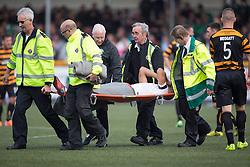Hibernian's Farid El Alagui injured and stretchered off.<br /> half time : Alloa Athletic 0 v 1 Hibernian, Scottish Championship game played 30/8/2014 at Alloa Athletic's home ground, Recreation Park, Alloa.