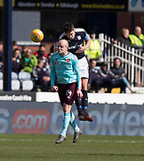 1st April 2018, Dens Park, Dundee, Scotland; Scottish Premier League football, Dundee versus Heart of Midlothian; Darren O'Dea of Dundee clears from Steven Naismith of Hearts