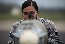 Senior Airman Angelica Melendez, 2nd Munitions Squadron conventional maintenance crew chief deployed from Barksdale Air Force Base, La., looks down a Guided Bomb Unit - 38 at RAF Fairford, England, March 21, 2019. Certain components on the GBU-38s had specific ways to be lined up once attached. Melendez checked to ensure those components were correctly placed. (U.S. Air Force photo by Airman 1st Class Tessa B. Corrick)
