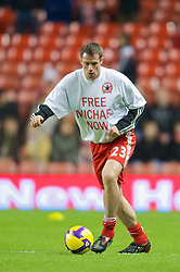 "LIVERPOOL, ENGLAND - Monday, December 1, 2008: Liverpool's Jamie Carragher warms up, wearing a ""Free Michael Now"" T-shirt, in support of Michael Shields, the Liverpool fan imprisoned in Bulgaria in 2005 for a crime he did not commit, before the Premiership match against West Ham United at Anfield. (Photo by David Rawcliffe/Propaganda)"
