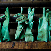 Ponte a Egola, Italy. 'Volpi SRL' tannery. .Gloves used for the extraction of leathers from 'drums' after the tanning.