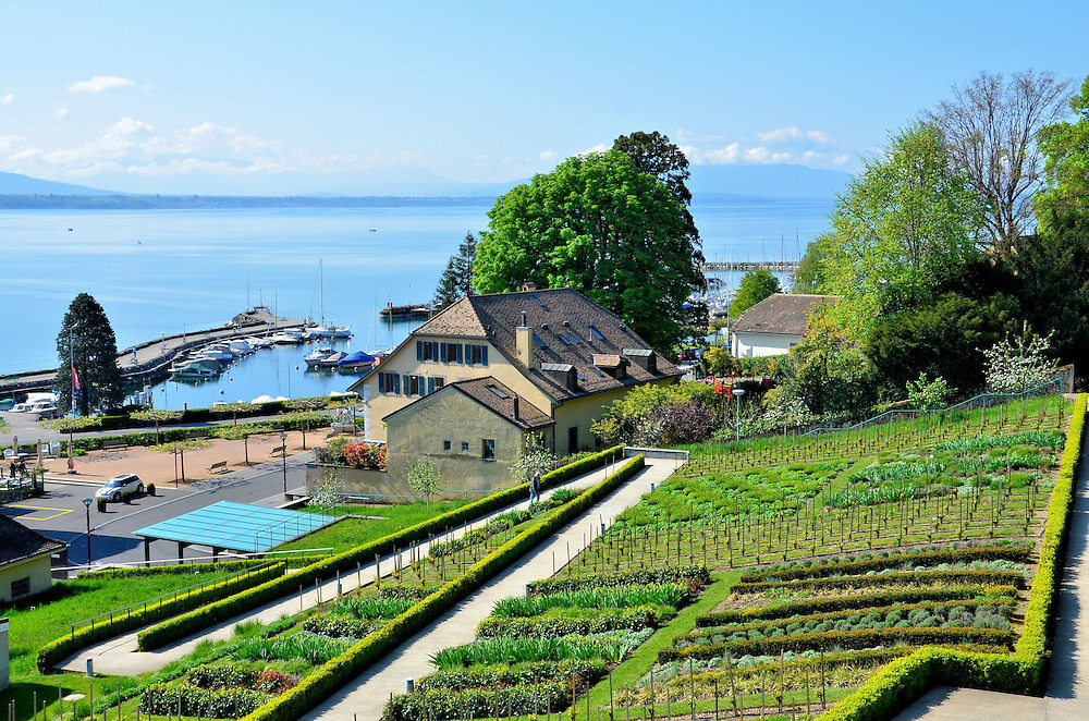 Terraced Garden, Harbor, and Lake Geneva in Nyon, Switzerland<br /> Take time when visiting Nyon, Switzerland, to wander along the old town walls, particularly the Promenade des Vieilles Murailles and the Esplanade des Marronniers for spectacular, panoramic views of the town below, terraced gardens, the harbor and Lake Geneva.  On a clear day you can see the Alps, nearby Geneva and the French coastline.