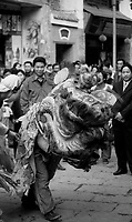 Lion dance being performed in West Street, Yangshuo, during Chinese New Year in 2002.