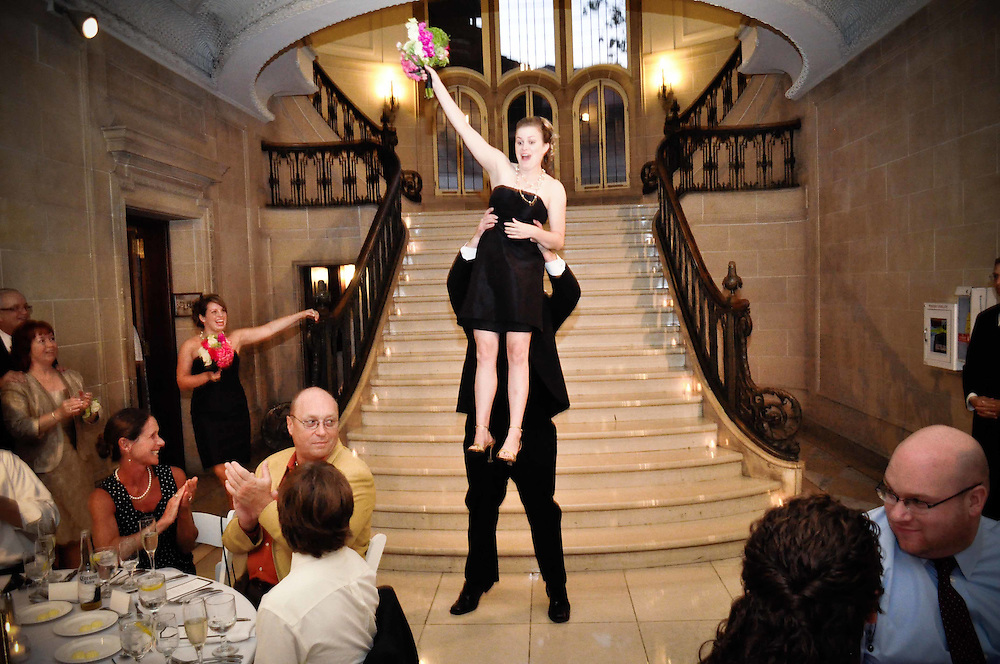 Kelly's bridesmaid gets a lift from a groomsmen during introductions at The Armour House, Lake Forest, IL