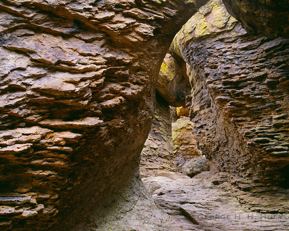 0103-1042 ~ Copyright:  George H. H. Huey ~ Grotto carved in volcanic rock by wind and water,  along the Echo Canyon Trail.  Chiricahua National Monument, Arizona.