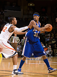 Hampton forward Donte Harrison (31) is guarded by Virginia forward Mike Scott (32).  The Virginia Cavaliers defeated the Hampton Pirates 74-48 at the John Paul Jones Arena on the Grounds of the University of Virginia in Charlottesville, VA on December 23, 2008. (Special to the Daily Progress / Jason O. Watson)