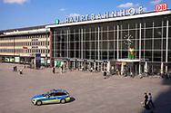 Coronavirus / Covid 19 outbreak, April 7th. 2020. Only few people infront of the main station, Police controls the square, Cologne, Germany.<br /> <br /> Coronavirus / Covid 19 Krise, 7. April 2020. Nur sehr wenige Menschen vor dem Hauptbahnhof Koeln, Polzei kontrolliert den Platz, Deutschland.
