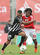 Nacional´s player Washington (L ) fights for the ball with Benfica's player Renato Sanches   (R ) during Portuguese First League football match Nacional vs Benfica  held at Madeira Stadium, Funchal, 11 January 2016.  LUSA / GREGORIO CUNHA