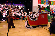 Lilly Smith as the bob-tail horse pulls a sleigh with driver Wyatt Paul and riders Remus Alfaydi, Brandon Thomas and Ms. Chrissy while Ms. Criss directs the Singing Colts as they perform Jingle Bells during the 'We Will Jingle!' arts concert at Cleveland PK-8 school in Dayton, Wednesday, December 12, 2012.