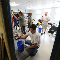 Paul Swales and other volunteers soend Thursday painting the interior of the Boys and Girls Vlub on North Green in Tupelo.