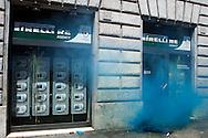 Roma 22 Giugno 2012.Manifestazione  dei sindacati di base contro le politiche economiche e sociali del Governo Monti..L'agenzia immobiliare Pirelli Re colpita dal lancio delle uova e  fumogeni dei manifestanti