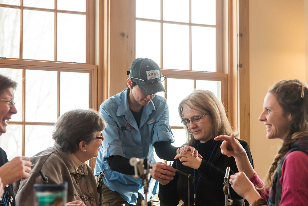 A fly tying class at the Michigan Department of Natural Resources Becoming an Outdoors Woman program at Bay Cliff Health Camp in Big Bay, Michigan.