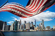 USA, New York:  A selection of pictures from the last week.<br /> A flag of The United States of America flies over a view of Manhattan, New York City. Rick Findler / Story Picture Agency
