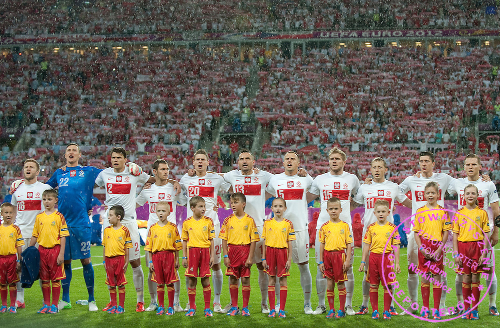 (L-R) Jakub Blaszczykowski (nr16) & goalkeeper Przemyslaw Tyton (nr22) & Sebastian Boenisch (nr02) & Ludovic Obraniak (nr10) & Lukasz Piszczek (nr20) & Marcin Wasilewski (nr13) & Dariusz Dudka (nr05) & Damien Perquis (nr15) & Rafal Murawski (nr11) & Robert Lewandowski (nr09) & Eugen Polanski (nr07) all from Poland while national anthem during the UEFA EURO 2012 Group A football match between Poland and Czech Republic at Municipal Stadium in Wroclaw on June 16, 2012...Poland, Wroclaw, June 16, 2012..Picture also available in RAW (NEF) or TIFF format on special request...For editorial use only. Any commercial or promotional use requires permission...Photo by © Adam Nurkiewicz / Mediasport
