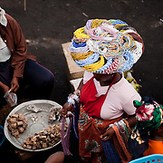 A woman selling bead necklaces in the main thoroughfare of Agbogbloshie, a slum in Ghana's capital, Accra.