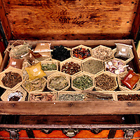 Chest of Moroccan Spices in Marrakech, Morocco<br /> Moroccans love their food with spices. A well-stocked kitchen contains essential ingredients such as garlic, figs, ginger, pepper, paprika, cumin, saffron threads, turmeric, yellow coloring, nutmeg, sesame seeds and bay leaves. Also important to North African cuisine is Ras el hanout. This is a mixture of ground spices and means &ldquo;head of the shop.&rdquo;