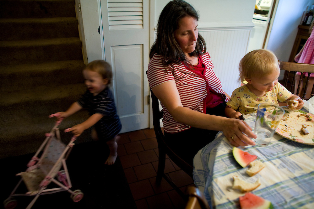Sharon Ferrell helps her daughter, Ivy, eat dinner at their home in Lincoln, CA May 13, 2009.