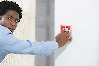 Man starting fire alarm indoors