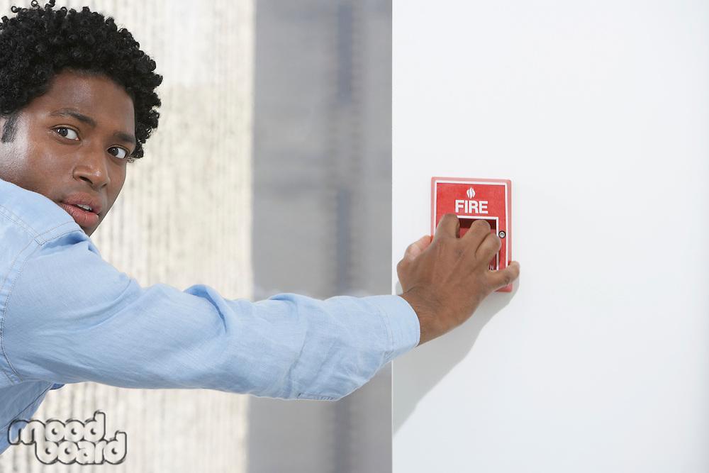Man starting fire alarm indoors
