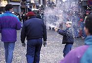 BEL, Belgium, Namur, Fosses-la-Ville, carnival, a boy attacks passerbys with foam spray.....BEL, Belgien, Namur, Fosses-la-Ville, Karneval, ein Junge besprueht Passanten mit Schaumspray.........
