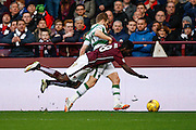 Celtic FC Midfielder Stuart Armstrong and Hearts FC Midfielder Prince Buaben collide during the Ladbrokes Scottish Premiership match between Heart of Midlothian and Celtic at Tynecastle Stadium, Gorgie, Scotland on 27 December 2015. Photo by Craig McAllister.