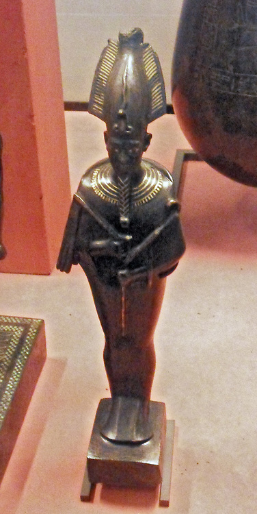 The god Osiris, Ptolemaic period? 332-30 BC, bronze with black patina, encrusted with gold thread, her eyes are silver