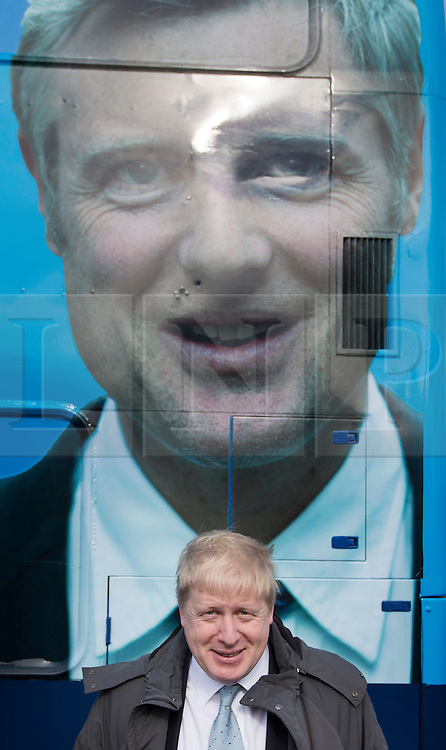 © Licensed to London News Pictures. 03/03/2016. London, UK. Mayor of London Boris Johnson stands under a photo of Conservative candidate for Mayor Zac Goldsmith seen on the side of his campaign bus in Sidcup. Photo credit: Peter Macdiarmid/LNP