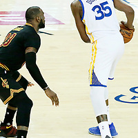 12 June 2017: Cleveland Cavaliers forward LeBron James (23) defends on Golden State Warriors forward Kevin Durant (35) during the Golden State Warriors 129-120 victory over the Cleveland Cavaliers, in game 5 of the 2017 NBA Finals, at the Oracle Arena, Oakland, California, USA.