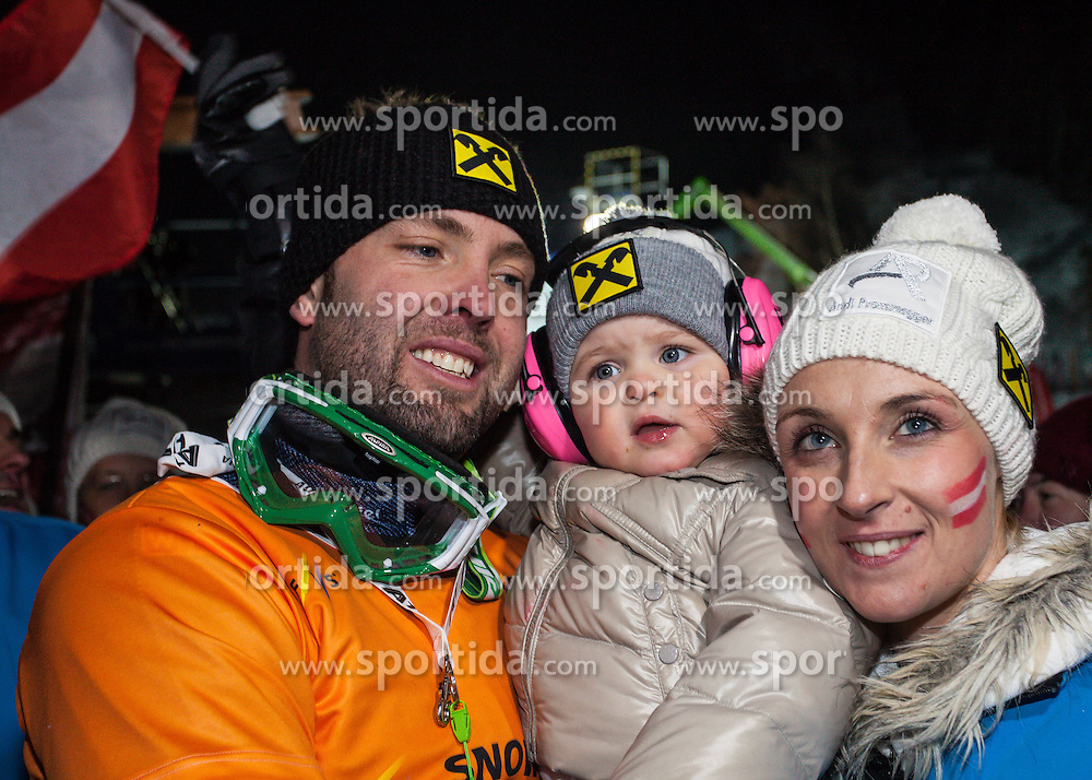 11.01.2013, Bucheben Piste, Bad Gastein, AUT, FIS Snowboard Weltcup, Herren, Parallelslalom, im Bild Sieger Andreas Prommegger (AUT) mit Tochter Laura und Lebensgefaehrtin Susi // Winnre Andreas Prommegger of Austria with Daughter Laura and Girlfriend Susi during Mens parallel Slalom of the FIS Snowboard Worldcup at the Bucheben Course, Bad Gastein, Austria on 2013/01/11. EXPA Pictures © 2013, PhotoCredit: EXPA/ Juergen Feichter