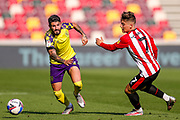 Huddersfield Town defender Pipa (2) and Brentford forward Sergi Canos (7) compete for the ball during the EFL Sky Bet Championship match between Brentford and Huddersfield Town at Brentford Community Stadium, Brentford, England on 19 September 2020.