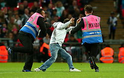 An England fan is apprehended by stewards after entering the pitch at Wembley - Mandatory by-line: Robbie Stephenson/JMP - 05/10/2017 - FOOTBALL - Wembley Stadium - London, United Kingdom - England v Slovenia - World Cup qualifier