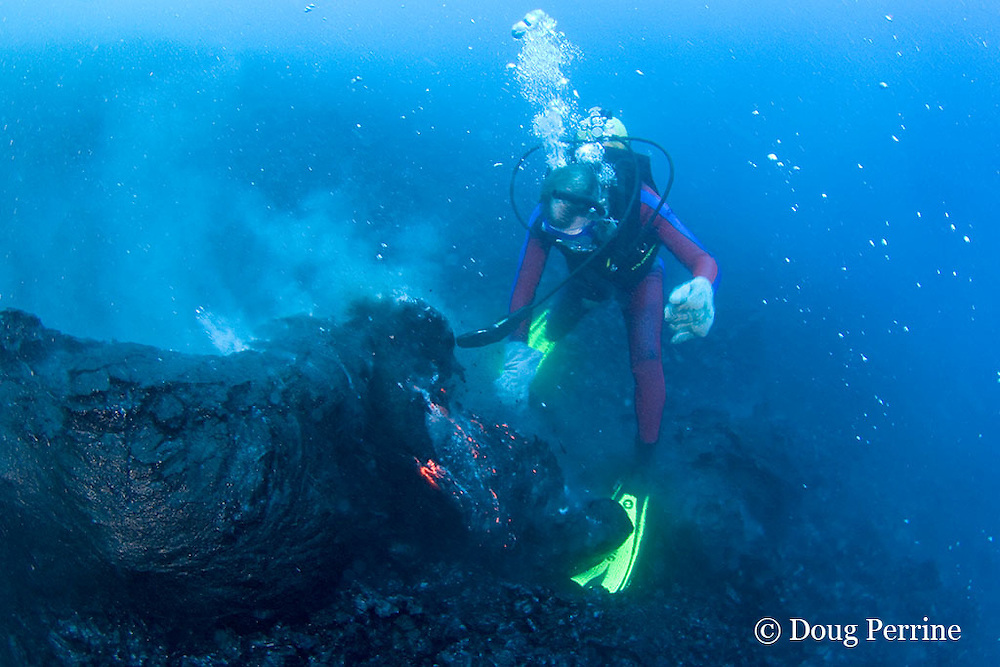 erupting pillow lava spills from active lava tube onto swim fin of diver Bud Turpin at ocean entry of Kilauea Volcano,<br /> Hawaii Island ( the Big Island ), Hawaii, U.S.A. ( Central Pacific Ocean ) MR 381