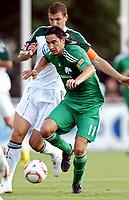 Fotball<br /> 20.07.2010<br /> Foto: Gepa/Digitalsport<br /> NORWAY ONLY<br /> <br /> VfL Wolfsburg vs Panathinaikos Athen<br /> <br /> Bild zeigt Sebastian Leto (Panathinaikos) und Edin Dzeko (Wolfsburg).