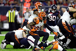 Cincinnati Bengals running back Jeremy Hill (32) rushes against the Houston Texans during the first half of an NFL football game Saturday, Dec. 24, 2016, in Houston. (AP Photo/Sam Craft)