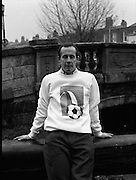 "Liam Brady Models World Cup Sweatshirt.  (T11)..1989..06.12.1989..12.06.1989..6th December 1989..To celebrate qualification for the World Cup at ""Italia 90"" a range of clothing was produced for the many fans who would travel to Italy. Thousands of Irish fans are already making arrangements to follow the 'Boys In Green', on hopefully a journey to World Cup glory...Image shows Ireland midfielder, Liam Brady, modeling one of the shirts produced for fans supporting the Irish team in Italy."