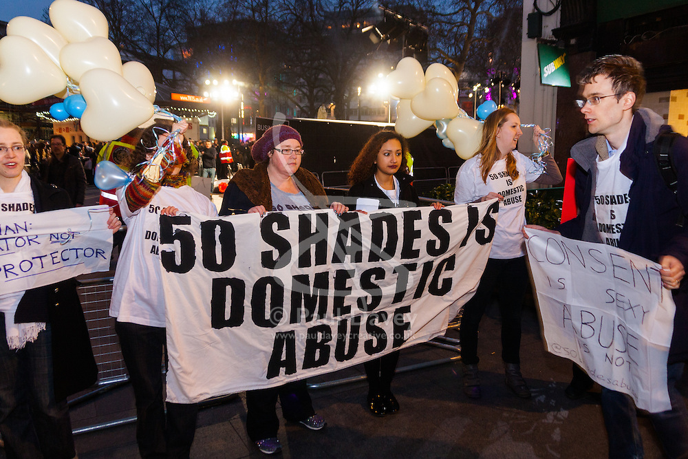 """Leicester Square, London, February 12th 2015. Women camoaigning against domestic violence demonstrate at the premiere of the much anticipated Fifty Shades of Grey in London's Leicester Square.The strong BDSM theme in the film is claimed by the protesters to """"celebrate domestic abuse"""" and the """"normalisation of abusive relationships""""."""