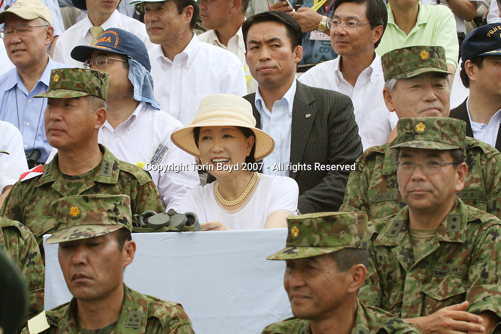 This is outgoing Japanese Defense Minister Yuriko Koike (with hat and gold necklace) who resigned from her post the day after this photo was taken. Koike opted out of continuing her post when Prime Minister Shinzo Abe reshuffled his cabinet on Aug. 27, 2007. She is seen here with top ranking officers of the Japan Ground Self Defense Force including General Ryuichi Oriki (on her immediate right), the Chief of Staff of the JGSDF's during the force's annual live fire exercise at the Higashi Fuji training range in Gotemba, Shizuoka Prefecture on Aug. 26, 2007.
