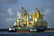 2 tug boats guide freighter past cruise ship; help, shipping industry, transportation, Fort Lauderdale; FL; Florida