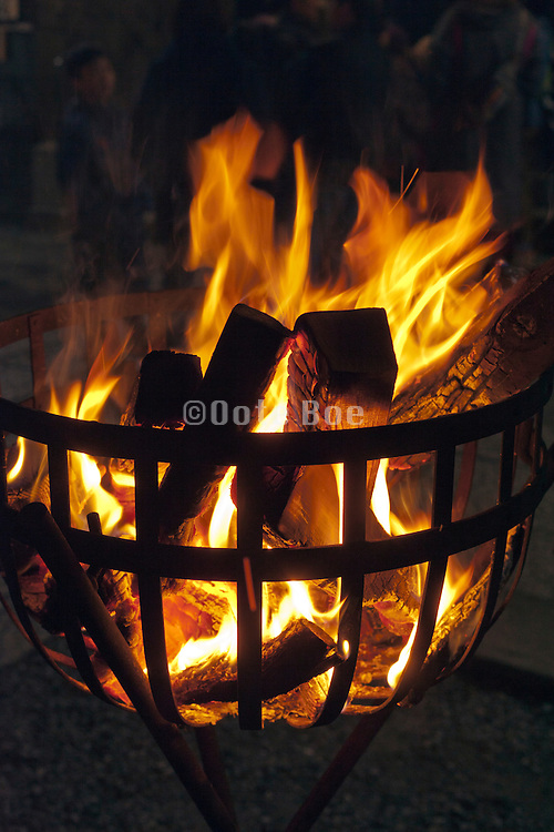 close up of wood fire burning basket Japan, New Year's Eve shrine