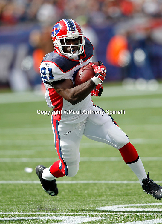 Buffalo Bills kickoff returner C.J. Spiller (21) runs the ball for a first down at the New England Patriots four yard line during the NFL regular season week 3 football game against the New England Patriots on September 26, 2010 in Foxborough, Massachusetts. The Patriots won the game 38-30. (©Paul Anthony Spinelli)