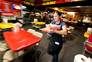 "Michele Rodriguez serving the famous Sonora Mexico style hot dogs at ""El Caprichoso"" in downtown Phoenix on August 19, 2016."