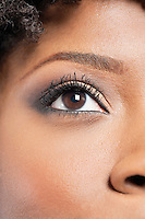 Cropped image of African American woman with eye makeup